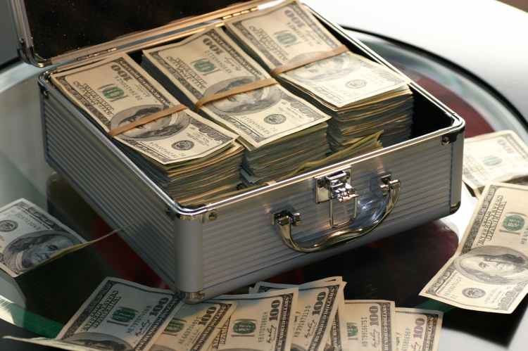 a stack of cash in a lock box like you could get for opening up a checking account with varo