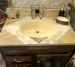 My bathroom sink with the tile pieces I had just laid on it