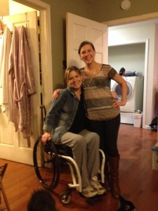 A picture of me in my wheelchair with my oldest daughter standing beside me